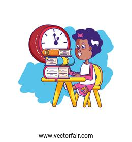 little student girl sitting in school desk with books and clock
