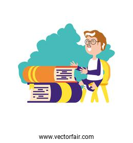 student boy sitting in chair with stack books
