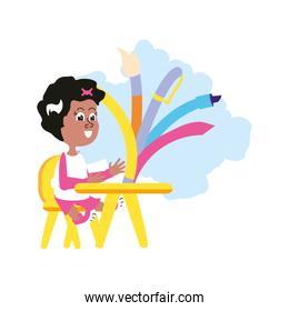 student girl sitting in school desk with set of pencils
