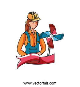 female builder with wind toy labor day