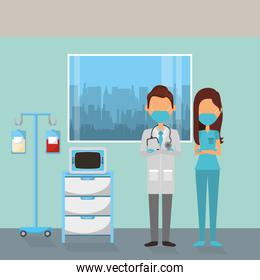doctors couple with face masks in workplace
