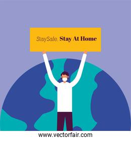 man with stay at home banner in earth planet