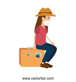 woman using face mask with suitcase