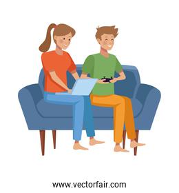 couple using laptop and playing video game