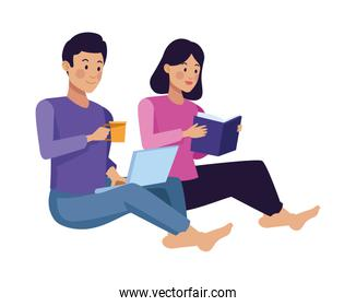 couple using laptop and reading book