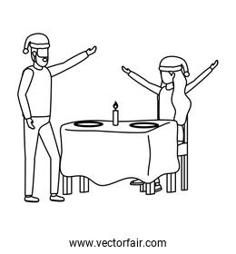 lovers couple with christmas hat in dinner table