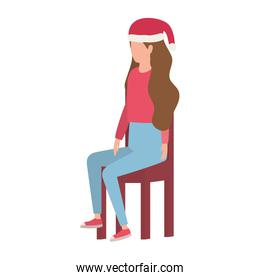 young woman with christmas hat seated in chair