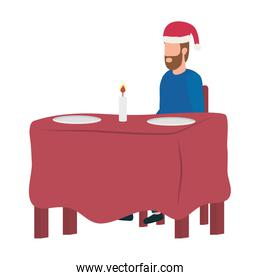 young man with christmas hat in dinner table