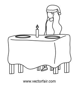 young woman with christmas hat seated in dinner table