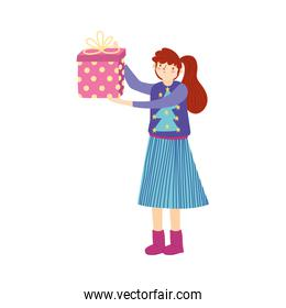 merry christmas woman with ugly sweater holding gift decoration over white