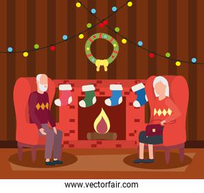grandparents couple in livingroom with christmas decoration