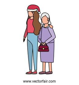 cute grandmother with daughter using christmas hat