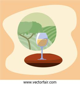 Wine cup in front of grapes tree vector design