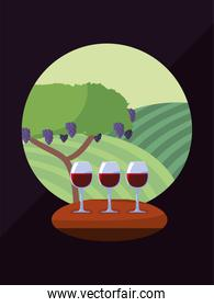 Wine cups in front of grapes tree vector design