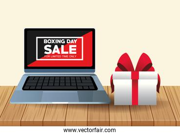 boxing day sale poster with laptop and gift