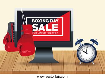 boxing day sale poster with desktop and alarm clock