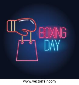 boxing day sale neon lights with glove and shopping bag