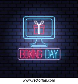 boxing day sale neon lights with desktop and gift