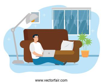 man working in telecommuting sitting in floor with laptop
