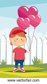 happy little boy with hearts balloons helium in the camp