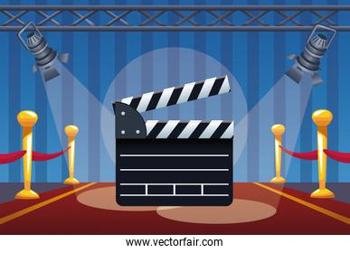 cinema entertainment with clapperboard and lamps