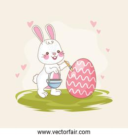 happy easter card with rabbit painting egg