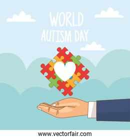world autism day with hand lifting puzzle heart