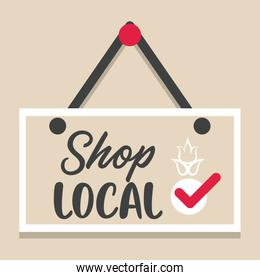 shop local poster with label hanging
