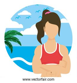 young woman athlete on the beach