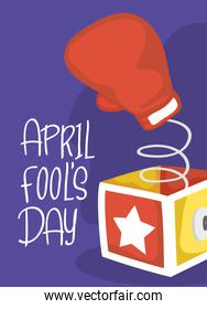 happy april fools day card with surprise box and boxing glove