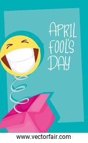 happy april fools day card with surprise box and emoji
