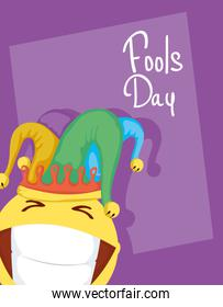 happy april fools day card with emoji crazy face and buffoon hat