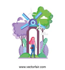 young woman windmill wind turbine trees ecology