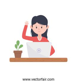 young woman using laptop with coffee and plant