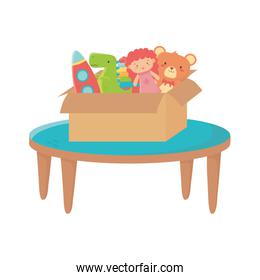 kids zone, table with box filled bear doll rocket dinosaur toys