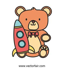 isolated  teddy bear and plastic rocket toys