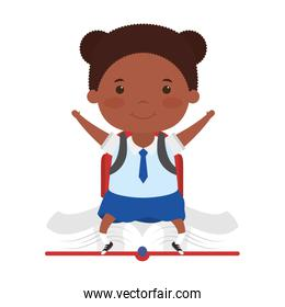 cute little student afro girl seated in book character