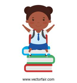 cute little student afro girl seated in books