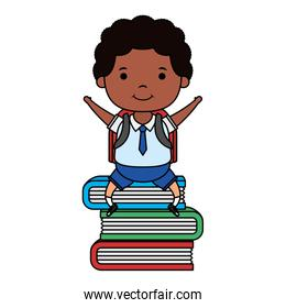 afro little student boy seated in books character