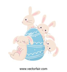 isolated cute rabbits with blue egg decoration