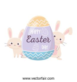 happy easter rabbits with lettering in egg decoration