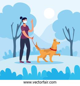 young woman using face mask walking with dog