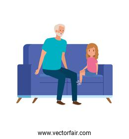 grandfather with granddaughter sitting in sofa