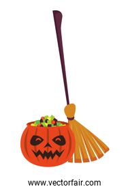 halloween pumpkin with sweet candies and witch broom