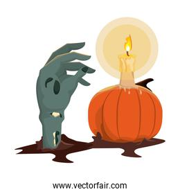 halloween pumpkin with candle and zombie hand