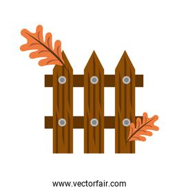 wooden fence with autumn leafs