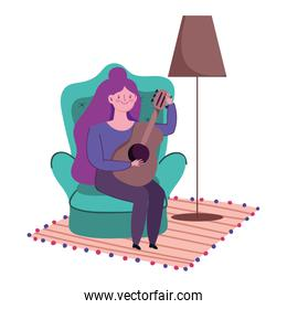 stay at home, young woman sitting playing guitar in room