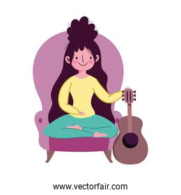 stay at home, young woman in chair with guitar leisure