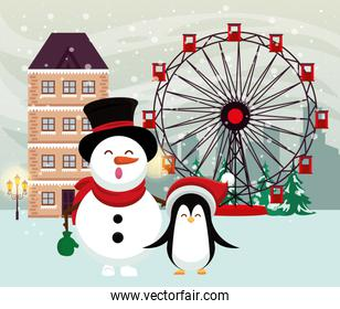 christmas snowscape scene with snowman and penguin