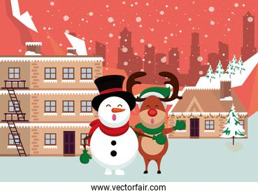 christmas snowscape scene with snowman and reindeer